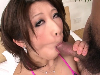 Busty Japanese hottie takes care of three cocks