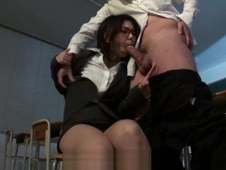 Horny Japanese teacher Minami Kitagawa blows her students hairy dick